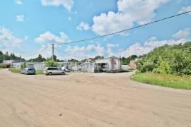 Parduodamas 12,35 a komercinės paskirties sklypas Pilaitėje su veikiančia automobilių plovykla.